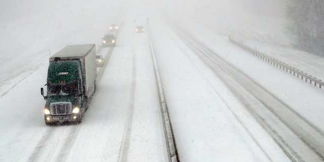 Traffic moves west along I-70 near Lawrence, Kan., Sunday. (AP Photo/Orlin Wagner)