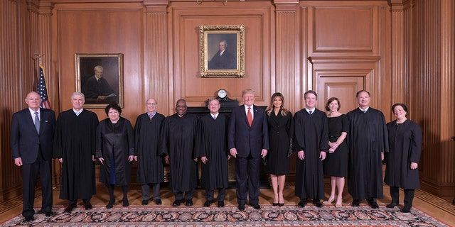 President Trump and Melania Trump pose with members of the Supreme Court, from left to right, retired Justice Anthony M. Kennedy, Associate Justices Neil M. Gorsuch, Sonia Sotomayor, Stephen G. Breyer, Clarence Thomas, Chief Justice John G. Roberts, Jr., Associate Justice Brett M. Kavanaugh, his wife Ashley Kavanaugh, Associate Justices Samuel A. Alito, Jr. and Elena Kagan.