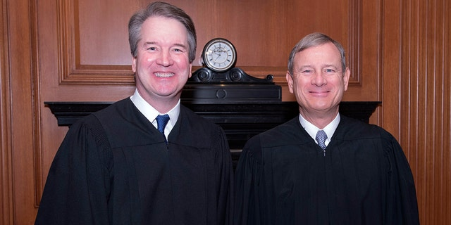 Associate Justice Brett Kavanaugh with Chief Justice John Roberts.