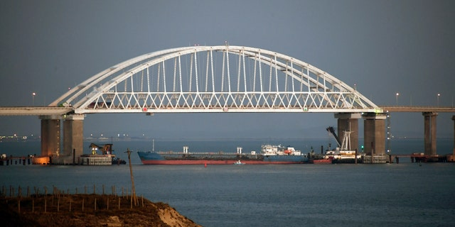 The Kerch bridge is seen blocked for ships entrance, near Kerch, Crimea, Sunday, Nov. 25, 2018. A Russian coast guard vessel rammed a Ukrainian navy tugboat near Crimea, damaging the ship's engines and hull, the Ukrainian navy said Sunday. (AP Photo)