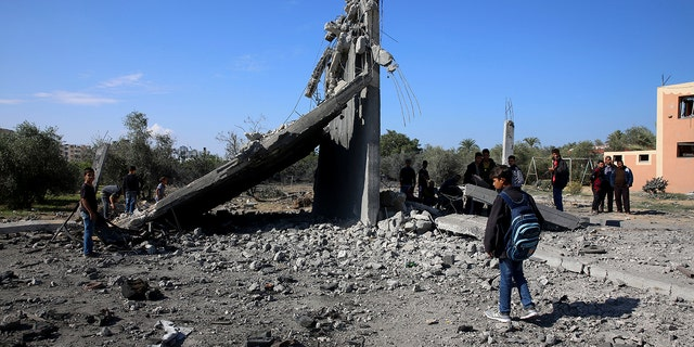 Palestinians inspect the damage from an Israeli raid that killed seven Hamas Palestinian militants, including a local Hamas commander, late Sunday, east of Khan Younis, southern Gaza Strip.