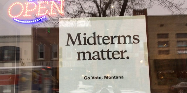 """A sign posted on a downtown Bozeman, Mont. coffee shop window reads """"Midterms matter. Go Vote, Montana"""" - it's a Patagonia sign, the outdoor company that's publicly endorsed Tester."""