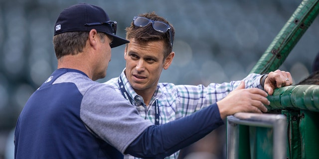 Seattle Mariners general manager Jerry Dipoto (R) talks with manager Scott Servais before a game between the Oakland Athletics and the Seattle Mariners at Safeco Field.