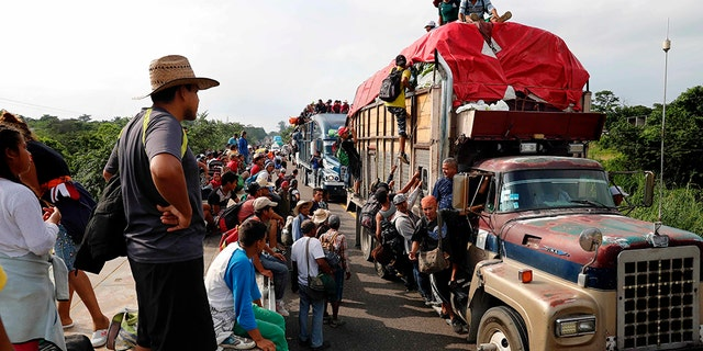 Central American migrants, part of the caravan hoping to reach the U.S. border, get a ride on trucks, in Donaji, Oaxaca state, Mexico, Friday. (AP Photo/Marco Ugarte)