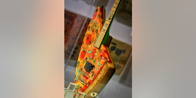 "The ""Pizza Guitar,"" from musician Andrew W.K., is part of a group art exhibition celebrating pizza at The Museum of Pizza in New York."