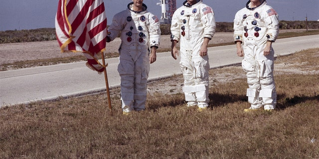 Apollo 9 astronauts, left to right, James McDivitt, David Scott, and RussellSchweickart, mount in front of a Apollo/Saturn V space automobile that would launch a Apollo 8 crew. The launch of a Apollo 9 (Saturn V launch vehicle, SA-504) took place on Mar 3, 1969. (NASA)