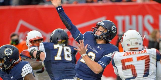 Notre Dame quarterback Ian Book throws a pass during an NCAA college football game against Syracuse.