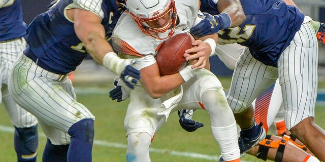 Syracuse quarterback Tommy DeVito is sacked by the Notre Dame defense during an NCAA college football game in New York City, Nov. 17, 2018.