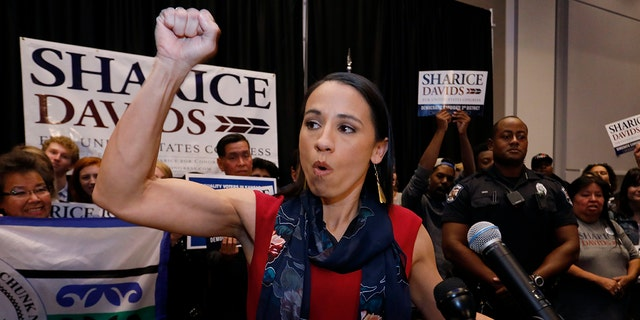 Democrat house candidate Sharice Davids reacts as she gives a victory speech to supporters at a victory party in Olathe, Kansas.