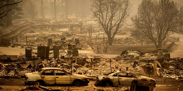 In this Monday, Nov. 12, 2018 file photo, homes leveled by the Camp Fireline a development on Edgewood Lane in Paradise, Calif.
