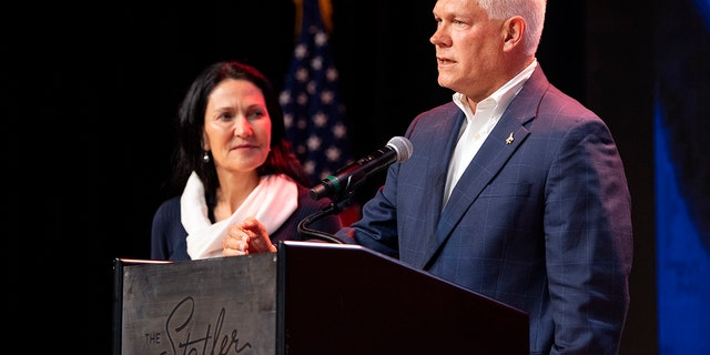 Incumbent U.S. Rep Pete Sessions, R-Texas, is joined by his wife on stage as he conceded the U.S. House race to Democratic challenger and first-time candidate Colin Allred. (AP Photo/Jeffrey McWhorter)