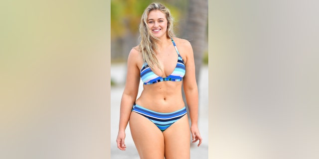 British model Iskra Lawrence wore a blue swimsuit during a photo shoot in Key Biscayne, Florida.