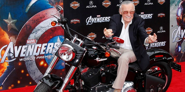 "Comic book creator and executive producer Stan Lee poses on a motorcycle at the world premiere of the film ""Marvel's The Avengers"" in Hollywood, California, April 11, 2012."