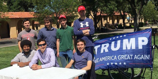"""The Stanford College Republicans holding a """"Change My Mind"""" tabling event on campus."""