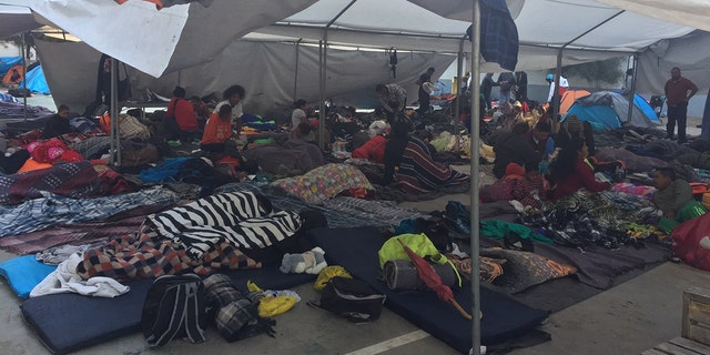 Tijuana has 700 shelter beds that are already full. So a municipal sports complex has turned into a tent city, with shivering migrants hunkering down in tents and sleeping on cots as they wait to determine their next steps.