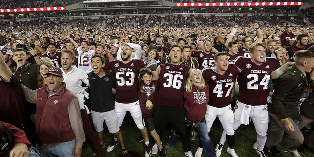 Fans and students join Texas A&M football players on the field after an NCAA college football game against LSU Saturday, Nov. 24, 2018, in College Station, Texas. Texas A&M won 74-72 in seven overtimes.(Associated Press)