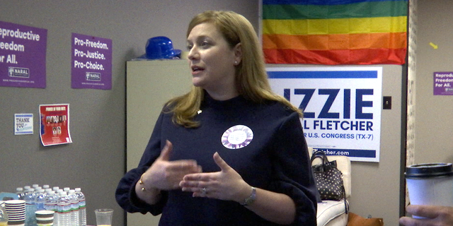 Democrat Lizzie Fletcher, who's looking to unseat Rep. John Culberson, speaks to volunteers at a campaign event in Houston.