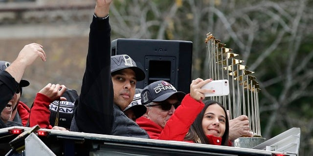 The World Series trophy was also pelted with a beer can.