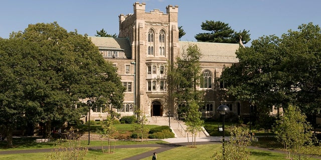 Officials say a 100-year-old oak tree will be removed during a planned renovation of Harvard Divinity School's Andover Hall.