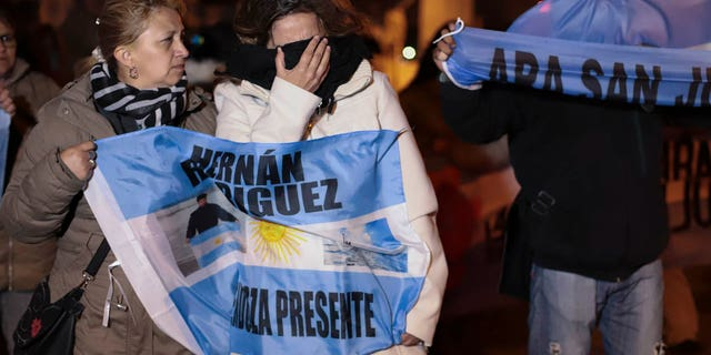 Relatives of the crew of the ARA San Juan submarine embrace outside the navy base in Mar del Plata, Argentina, Saturday, Nov. 17, 2018. Argentina's navy announced early Saturday, that they have located the missing submarine ARA San Juan in the Atlantic a year after it disappeared with 44 crew members aboard.