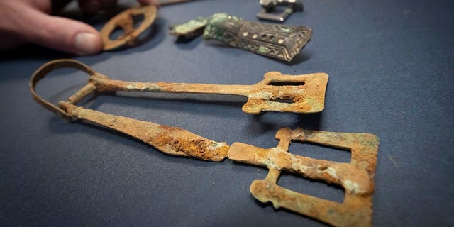 Some of the artifacts discovered during excavations at a previously unknown Anglo-Saxon cemetery that unearthed lavish burials of women with their jewelry and personal items. (Press Association via AP Images)