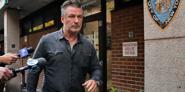 In this Nov. 2, 2018, file photo, actor Alec Baldwin walks out of the New York Police Department's 10th Precinct, in New York, after he was arrested for allegedly punching a man in the face during a dispute over a parking spot outside his New York City home, authorities said.