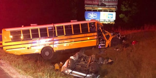 One person died, and 11 others were injured Tuesday night when a truck collided with a school bus full of kids on an interstate in Alabama.
