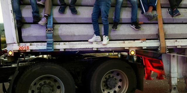 Central American migrants moving as a caravan toward the U.S. border get a free ride on a truck at Ixtlán del Rio, Nayarit, Mexico, Tuesday, Nov. 13, 2018.