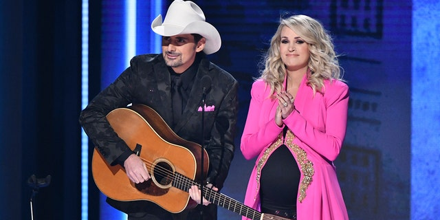 Hosts Brad Paisley, left, and Carrie Underwood appear at the 52nd annual CMA Awards at Bridgestone Arena on Wednesday, Nov. 14, 2018, in Nashville, Tenn.