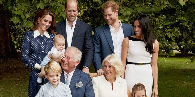 Images are part of a set to mark His Royal Highness's 70th birthday. Prince Charles, Prince of Wales with Prince Louis of Cambridge and Catherine, Duchess of Cambridge after a family portrait photo-shoot in the gardens of Clarence House on September 5, 2018 in London, England. (Chris Jackson/Getty Images for Clarence House).