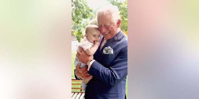 Images are part of a set to mark His Royal Highness's 70th birthday. Prince Charles, Prince of Wales holds Prince Louis of Cambridge after a family portrait photo-shoot in the gardens of Clarence House on September 5, 2018 in London, England. (Chris Jackson/Getty Images for Clarence House).