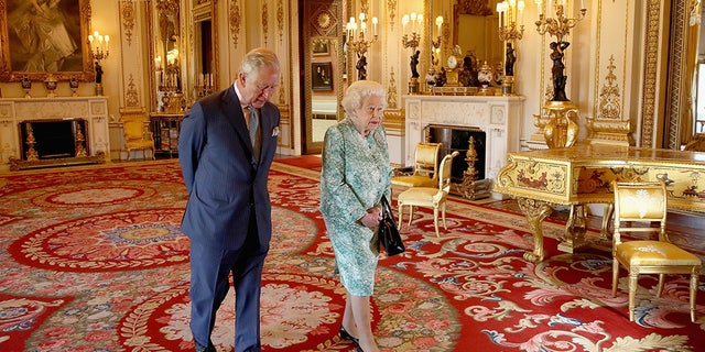 Images are part of a set to mark His Royal Highness's 70th birthday. Prince Charles, Prince of Wales and Queen Elizabeth II walk out ahead of the formal opening of the Commonwealth Heads of Government Meeting (CHOGM), in the ballroom at Buckingham Palace on April 19, 2018 in London, United Kingdom. (Chris Jackson/Getty Images for Clarence House)