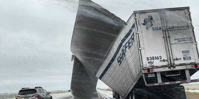 This Nov. 25, 2018 photo which was released by the Nebraska State Patrol, shows a broken up trailer amid blowing snow on Interstate 80 near Bradshaw, Neb.