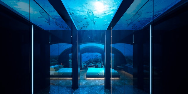 """Below the waves, a """"curved ceiling, wide windowsand fish peep show bathroom"""" will surely make for an once-in-a-lifetime experience —thought it may be a bit difficult to fall asleep, as fish, turtles, stingraysand sharks swim by your beside."""