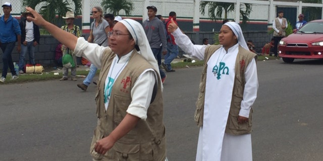 Two Catholic nuns from Guadalajara's Misioneras de Christo Resuscitado flag down big rig in effort to aid migrants on Sunday, November 4, 2018.