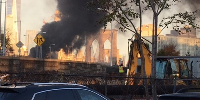 The fire halted the morning commute on the Brooklyn Bridge on Wednesday, Nov. 21, 2018.
