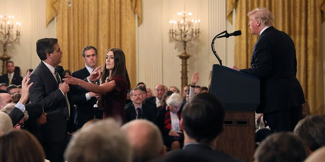 CNN's Jim Acosta questions U.S. President Donald Trump during his news conference following Tuesday's midterm U.S. congressional elections at the White House in Washington, U.S., November 7, 2018. REUTERS/Jonathan Ernst - RC189F0AFAA0