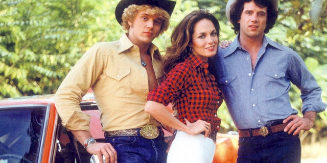 "American actors John Schneider, Catherine Bach and Tom Wopat in a promotional portrait for the TV show 'The Dukes of Hazzard"" circa 1980."