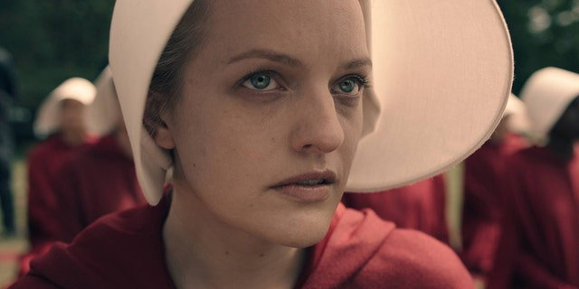 "Elisabeth Moss stars as Offred in Hulu's ""The Handmaid's Tale"" based on Margaret Atwood's book."