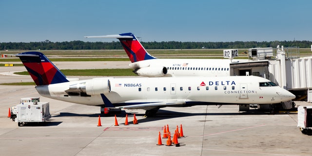 "The FBI has announced that the woman who managed to board a Delta Air Lines flight from at Orlando International Aiport without an ID or boarding pass last weekend will not be charged ""at this time"" for her actions."