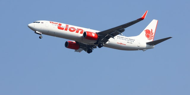 Chiangmai, Thailand - February 26, 2014: HS-LTH Boeing 737-900ER of Thai Lion Air , landing at Chiangmai airport from Bangkok.<br>