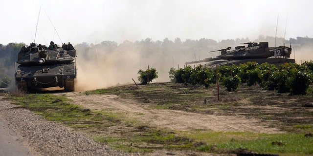 Israeli tanks move near the Israel Gaza border on Tuesday.