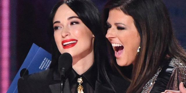 "Karen Fairchild of Little Big Town, right, embraces Kacey Musgraves, winner of the award for album of the year for ""Golden Hour"" at the 52nd annual CMA Awards at Bridgestone Arena on Wednesday, Nov. 14, 2018, in Nashville, Tenn."