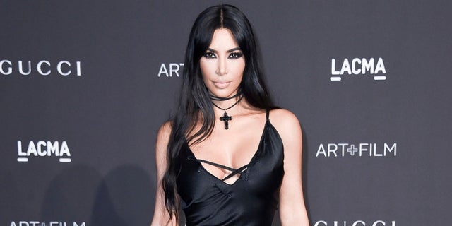 Kim Kardashian came under fire on Halloween for calling people who didn't recognize her costume the R-word.