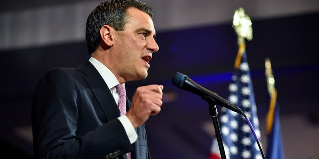 Incumbent Republican U.S. Rep. Kevin Yoder talks to supporters as he concedes his seat after he lost the Kansas 3rd District to Democrat Sharice Davis Tuesday, Nov. 6, 2018, in Overland Park, Kan. (AP Photo/Ed Zurga)