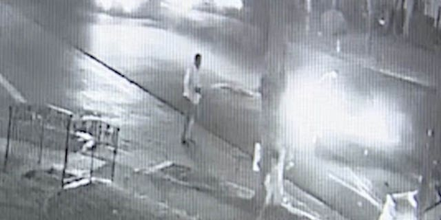 Mohamed Abdi Mohamed can be seen standing outside his vehicle after crashing into another car on Friday.
