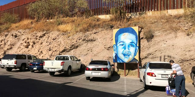 The boundary in Nogales, Mexico where a poster of Jose Antonio Elena Rodriguez hangs.
