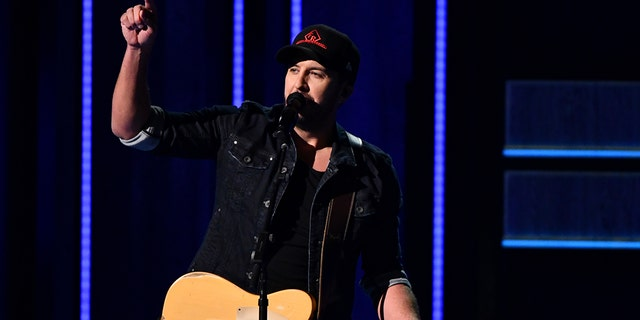 """Luke Bryan performs """"What Makes You Country"""" at the 52nd annual CMA Awards at Bridgestone Arena on Wednesday, Nov. 14, 2018, in Nashville, Tenn."""
