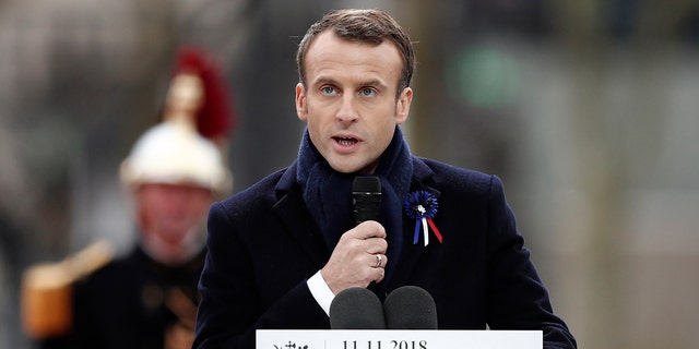 French President Emmanuel Macron delivers his speech as he attends a commemoration ceremony for Armistice Day, 100 years after the end of the First World War at the Arc de Triomphe in Paris, France, Sunday, November 11, 2018.