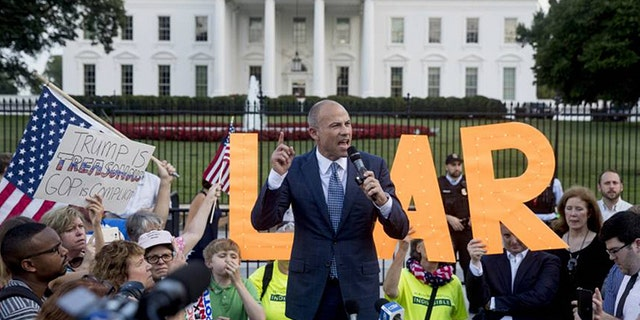 "In this July 17, 2018, file photo, Michael Avenatti, attorney for porn star Stormy Daniels, speaks at an ""Occupy Lafayette Park"" protest outside the White House in Washington."
